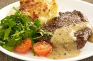 Steak with brandy and peppercorn sauce