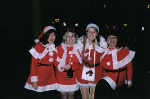 Susan and her friends dressed in santa outfits