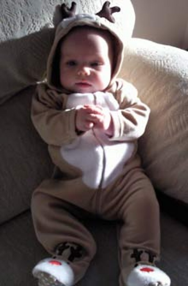 Baby Josh dressed as a reindeer