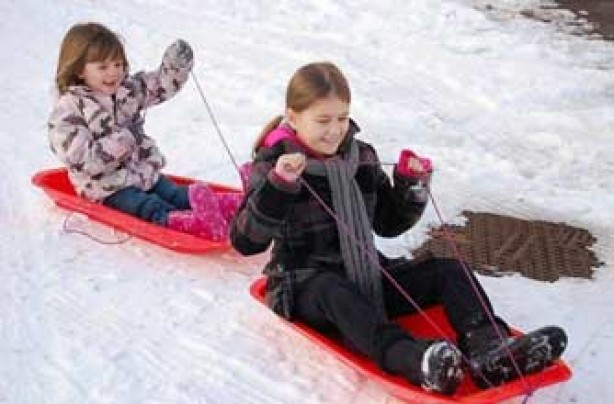 Charlotte's daughter and her friend sledging in Rochdale