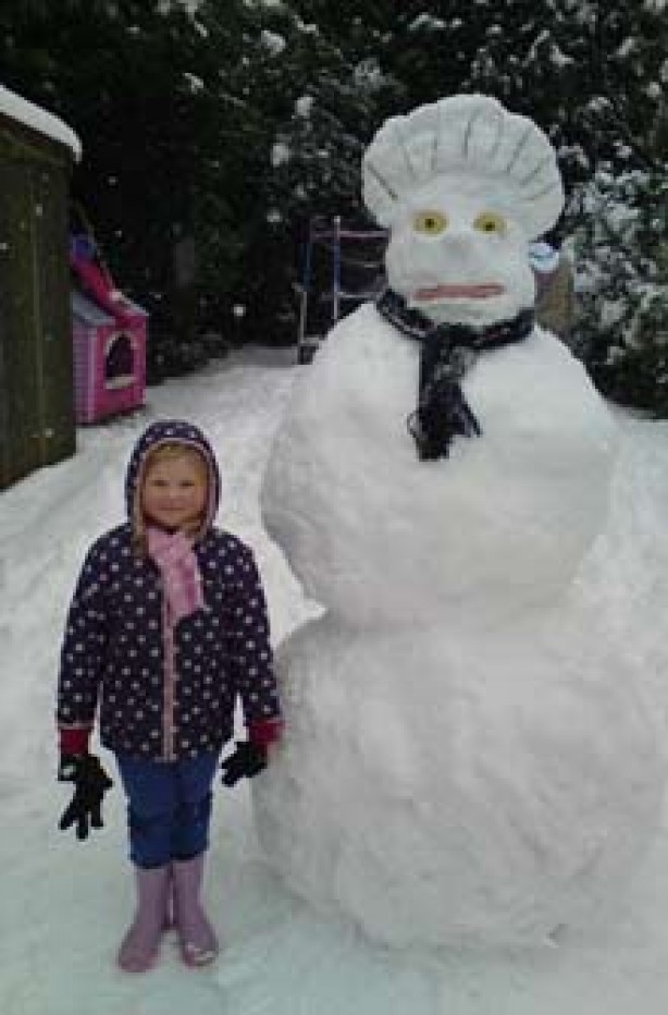 4-year-old Lydia and her giant snowman