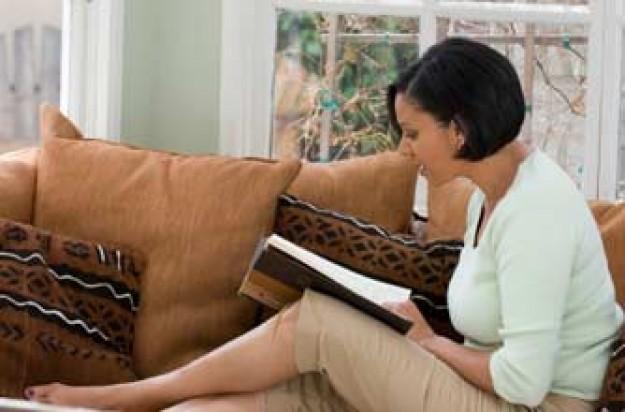Woman reading, book, sofa