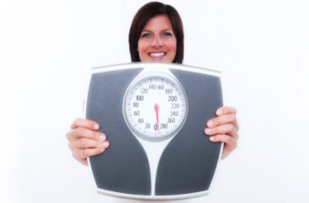 BMI Calculator: Woman holding scales