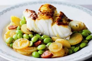 Spiced cod on a bed of chorizo-infused beans