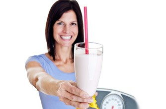 Woman holding milkshake