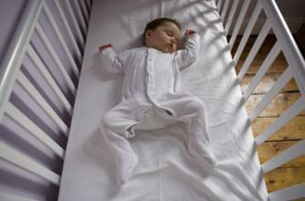 Baby asleep in cot