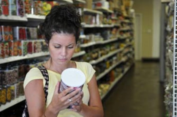 woman checking food labels in a supermarket