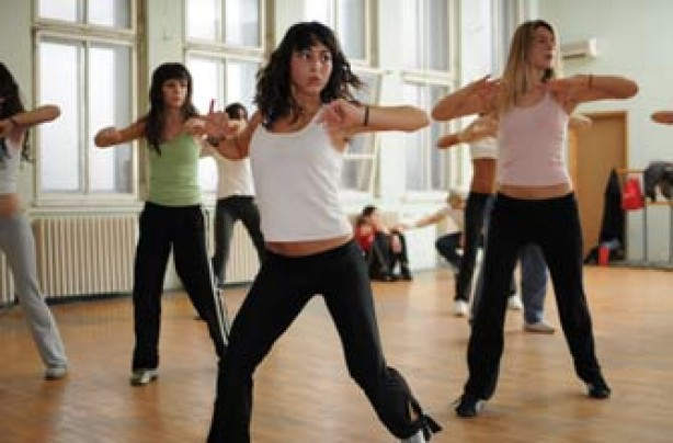 women dancing in a gym