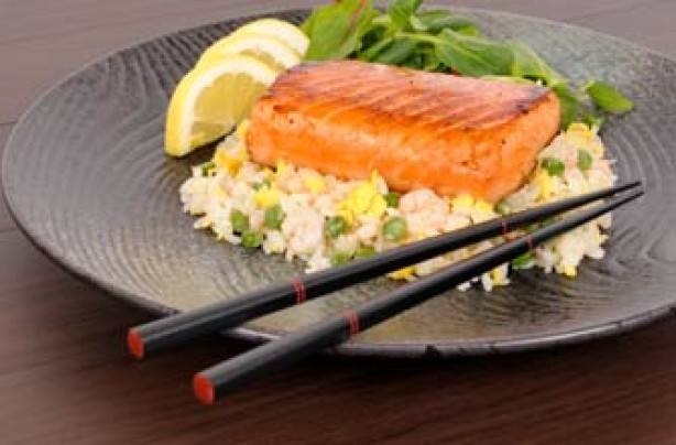 salmon and rice with chopsticks