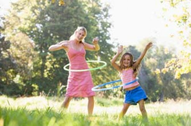 mother and daughter playing hula hoop