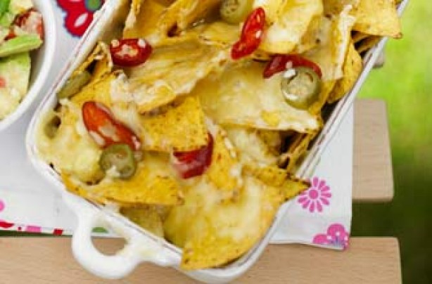 Essentials magazine, loaded nachos with chunky guacamole