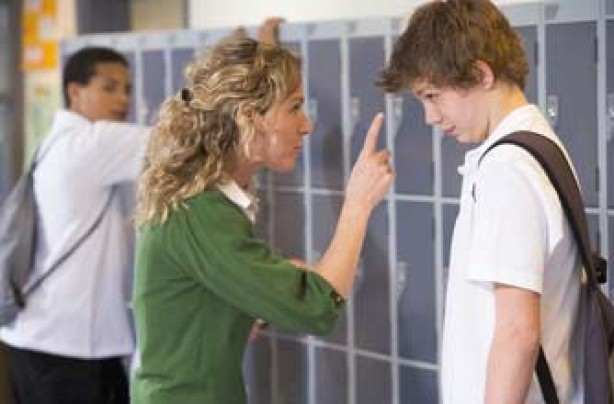 Teacher telling off a pupil