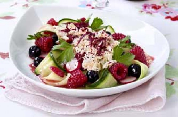 A refreshing cucumber and berry salad with crab meat