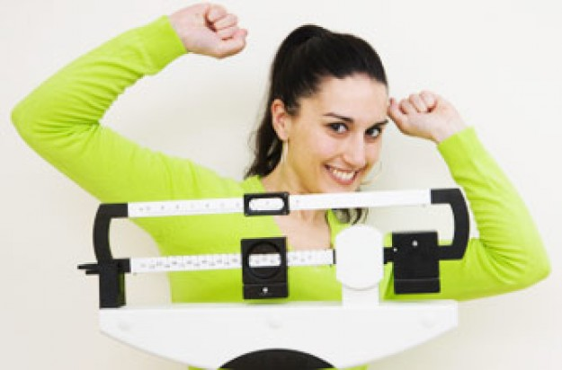 Woman on scales, weightloss