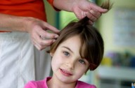 Girl having her hair inspected for head lice