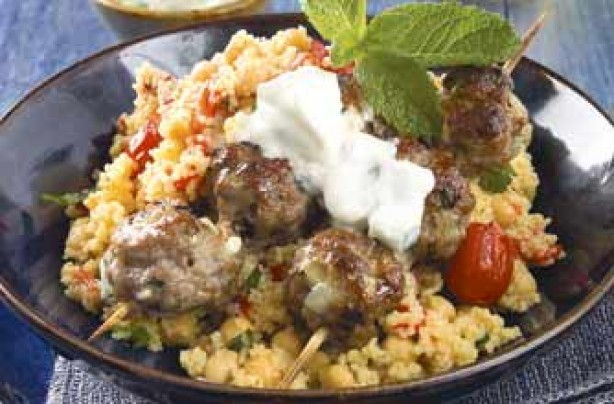 Grilled lamb mince balls in bamboo skewers. This is served with chickpeas, couscous and peppers. For added zing, werve with tzatziki