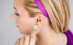 Woman putting in ear plugs