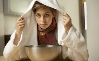 Natural remedies for coughs and colds: Woman inhaling steam