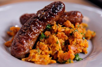 Nigel Slater's mustard & lemon sausages with carrot mash