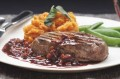 A rich red wine sauce is served with pan fried fillet steak. This steak is moist, tender and very tasty.