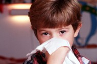 Boy with tissue: Keeping children safe from flu