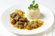 Lamb stew with apple and sour plums
