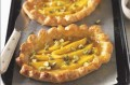 Fresh mangoes are baked on ready made pastry cases. This is great after a meal or as a snack. It is also quick and easy to make.