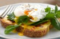 Cheese toasties with spinach and poached egg