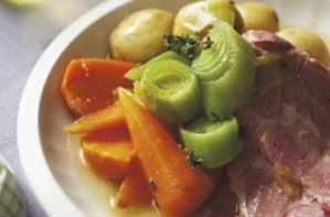 A bacon collar joint is slow cooked in ale with carrots, potatoes and leeks. This one pot serves 4.
