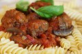 Beef meatballs in tomato and mushroom sauce