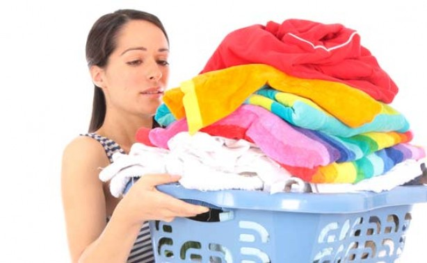 Woman carrying a pile of washing
