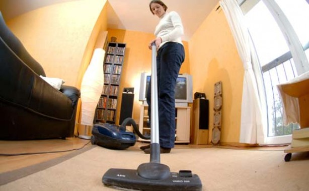 A woman vacuuming