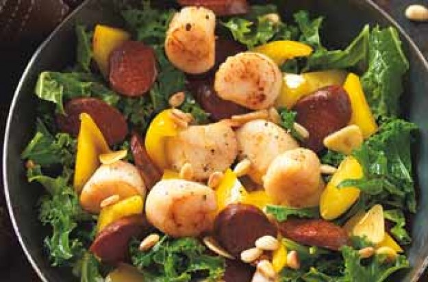 Scallops, kale, yellow pepper and Spanish chorizo are stir-fried in this delicious seafood dish. Pine nuts are added for crunch. Serve it as a starter or main and eat with bread, rice or potatoes