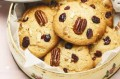 This cookie is crisp and crunchy with bites of pecan nuts and sweet cranberries. It is easy and quick to make. 