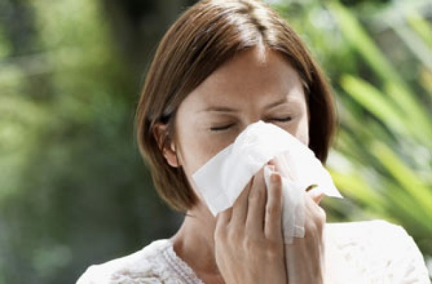 Woman suffering from hay fever symptoms