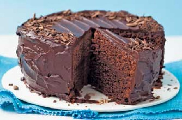 This large cake feeds 16 people. It is beautifully decorated with glossy chocolate icing. The cake is soft and moist with a hint of Marsala brandy. A delight to serve for any occasion.