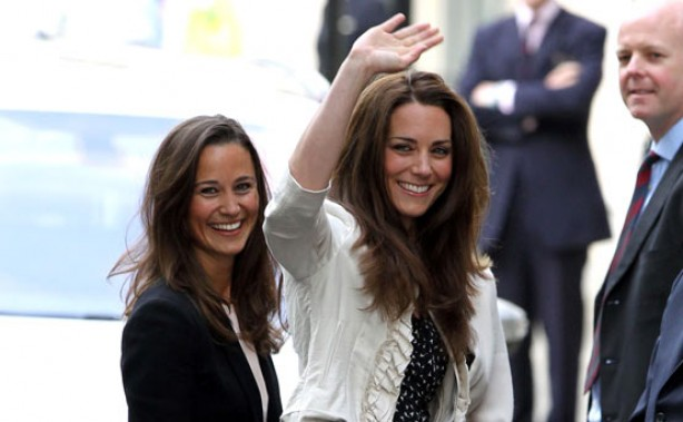 Kate Middleton waves to the crowds the night before her wedding