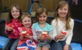 Girls enjoying their Royal Wedding cupcakes