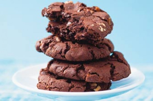This recipe makes 10 generous size cookes. They are crunchy and yet gooey. Chopped chocolate and pecan nuts add crunch.