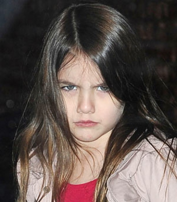 Suri Cruise is pictured looking fed up