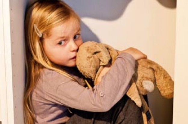 Little girl holding a soft toy