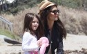 Suri Cruise on the beach with mum Katie Holmes