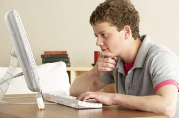 Teenage boy on the computer