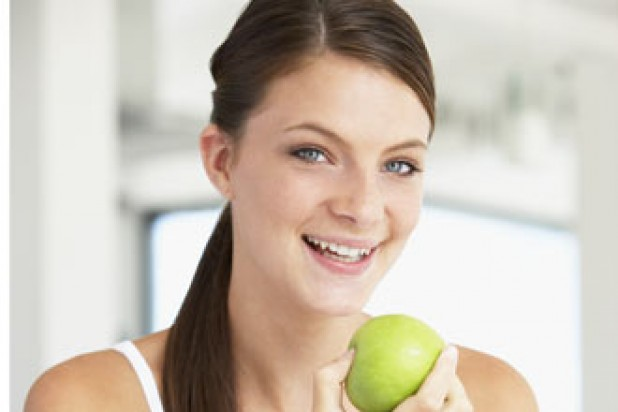 Lady eating apple