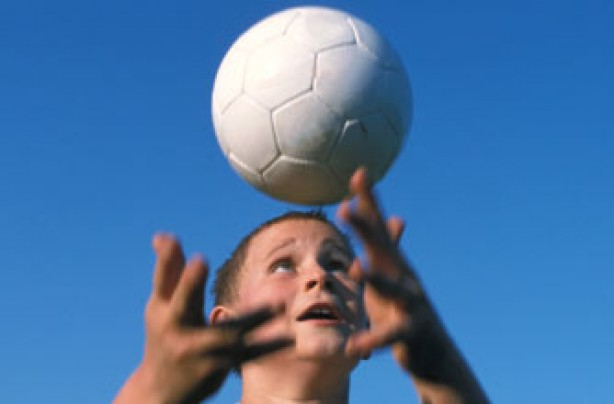 boy catching a ball