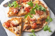 A quick and easy pizza made with ready made piaaz base. It takes only 15 mins to bake.