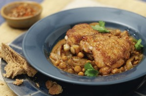 A mildly spiced chicken simmered with chickpeas. This is very tasty for the whole family. Although it takes a bit of effort in cooking, it is worth the work.