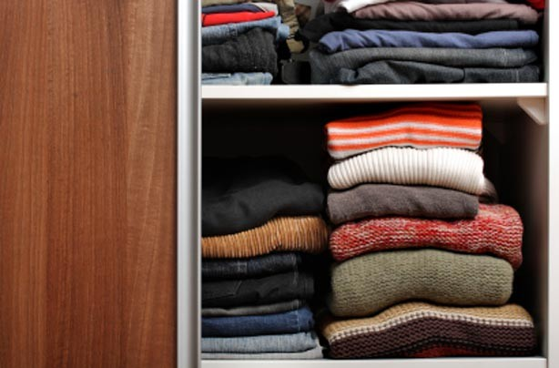 Jumpers in wardrobe