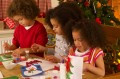 Kids making Christmas crafts and Christmas cards