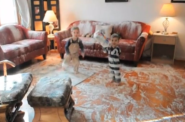 Kids up to mischief: Two boys destroying their home with flour